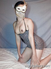 Lovely girl in mask posing