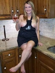 Exposed Suburban MILF in kitchen