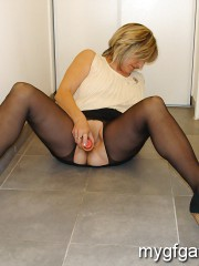 Mature lady masturbating and playing with toys