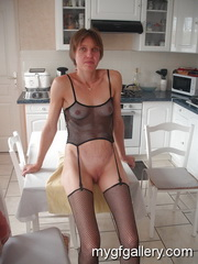 French mature posing in kitchen