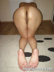 Wife presenting her soles and holes