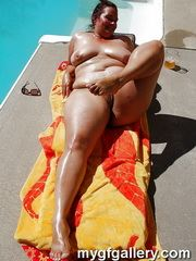 Sexy BBW MILF posing round the pool