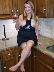 Exposed Suburban MILF in kitchen
